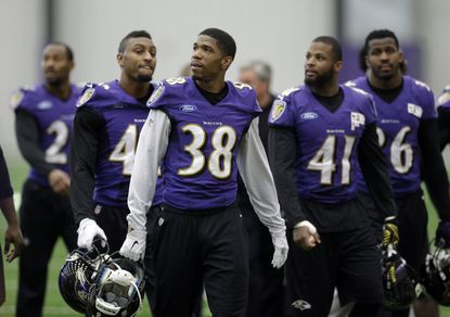 Ravens cornerback Rashaan Melvin walks off the field with teammates after practice Wednesday.