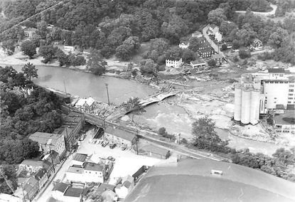 As shown in this aerial photo, parts of historic Ellicott City and, across the river, Oella, were under water for days when Tropical Storm Agnes swept through the region, dumping 10 to 14 inches of rain on already saturated areas.