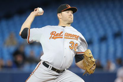 Orioles right-hander Chris Tillman pitches in the second inning against the Toronto Blue Jays at Rogers Centre.