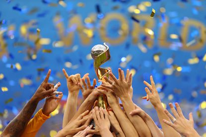 U.S. players celebrate with the FIFA Women's World Cup Trophy following victory July 7 in the 2019 FIFA Women's World Cup France Final match between the United States and the Netherlands in Lyon, France.