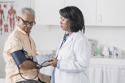 Doctor checking African American man's blood pressure. According to the Centers for Disease Control and Prevention (CDC), Black men are 30% more likely to die from heart disease than white males, 36% of Black men are obese, and nearly 4 million African Americans age 20 and up have diabetes.