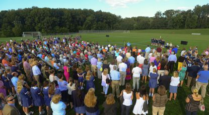 Several hundred people attend the dedication of Yeardley Love Field at Notre Dame Preparatory School in Towson.