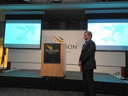 Kevin King, an associate principal at the architectural firm Ayers Saint Gross, talks to residents about Towson University's master plan update process at a community input meeting Monday.