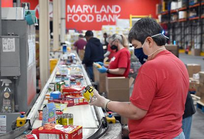 Volunteer Maria Engelbrecht, of Columbia, sorts items on a conveyor belt at the Maryland Food Bank on March 25.