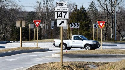 Drivers navigate the new roundabout at Harford and Mt. Vista roads that was recently completed and reopened to traffic.