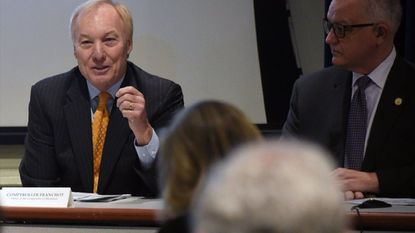 Annapolis, Md--1/25/18--Comptroller Peter Franchot holds a news conference to release a report on federal tax changes. Secretary David Brinkley, Budget and Management, is on right. Kim Hairston/Baltimore Sun.