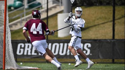 Pat Spencer (in white), a senior attackman for the No. 8 Loyola Maryland men's lacrosse team, is a semifinalist for the Tewaaraton Award for the third year in a row.