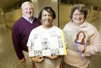 Ed Miller of York, Mary Miller of Perry Hall and Cindy Horn of Fallston pose for a portrait with a yearbook from 1965 and Horn's senior photo at Perry Hall High School. Ed and Mary were a part of the original graduating class of '65 from the school. Horn graduated in '78.