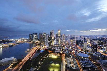 The Sky-High Valentine's Romance Package at Swissotel The Stamford offers dinner for two on a helipad with views of the Singapore skyline.