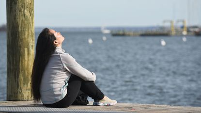 Li Ping Mei soaks up the January sunshine at Susan Campbell Park at City Dock in Annapolis.
