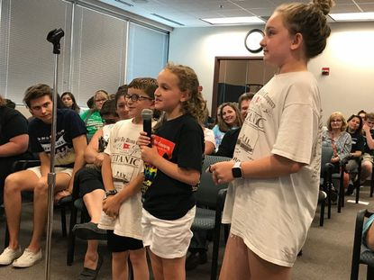 """Siena Bauer, center, called the Bel Air Drama Company her second home, """"her place,"""" telling the Harford County Board of Education she instantly felt at home there. She is standing with James Tackett, left, and Anna Tackett."""