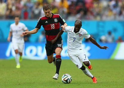 Toni Kroos of Germany challenges DaMarcus Beasley of the United States during the 2014 FIFA World Cup Brazil group G match between the United States and Germany at Arena Pernambuco on June 26, 2014 in Recife, Brazil.