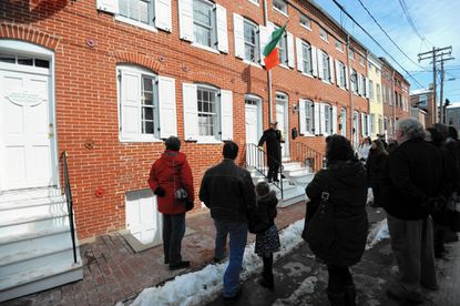 Judge Tom Ward leads a 2015 tour of the W Baltimore neighborhood as it relates to Irish history. He is on the steps of The Irish Railroad Workers Museum, 918-20 Lemmon St., which on Saturday will host a commemoration the great famine at 1 p.m.