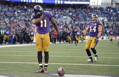 Baltimore Ravens wide receiver Kamar Aiken (11) gestures in front of teammate Baltimore Ravens fullback Kyle Juszczyk after scoring a touchdown in the first half of an NFL football game against the Kansas City Chiefs, Sunday, Dec. 20, 2015, in Baltimore.