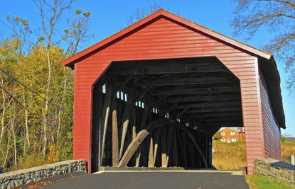 Utica Mills Covered Bridge. The Burr Arch Truss construction is partly visible from the entrance.