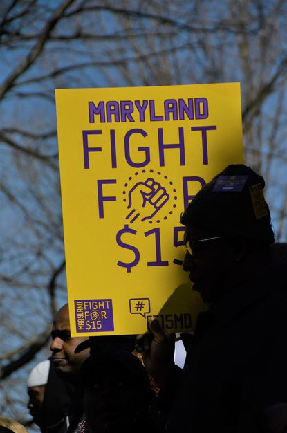 Members of the SEIU 1199 union demonstrate outside the State House in Annapolis on Wednesday, March 13, 2019, urging lawmakers to pass a bill gradually increasing the minimum wage to $15 per hour.