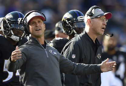 Ravens coach John Harbaugh, left, and special teams coordinator/associate head coach Jerry Rosburg react to a penalty call in the second half against the Cleveland Browns, Sunday, Oct. 11, 2015, in Baltimore.