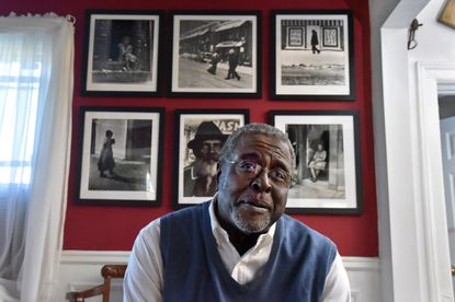 """John Clark Mayden, 69, has trained his lens on the city and its residents for 50 years. He's published a book of his powerful black-and-white images, some of which were selected for the HBO film on Ta-Nehisi Coates' book, """"Between the World and Me."""""""