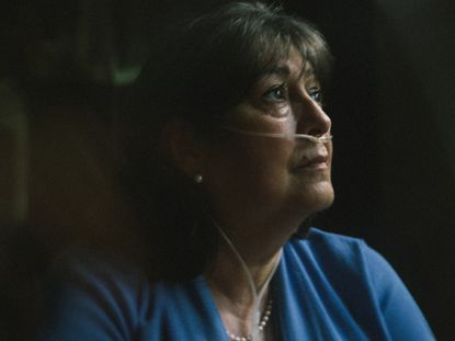 Manuella Fehertoi, who has been unable to work her banking job and now needs oxygen around the clock, at her home in Middletown, N.J., Sept. 1, 2020. With 7 million known cases of the coronavirus across the country, more people are suffering from symptoms that go on and on.