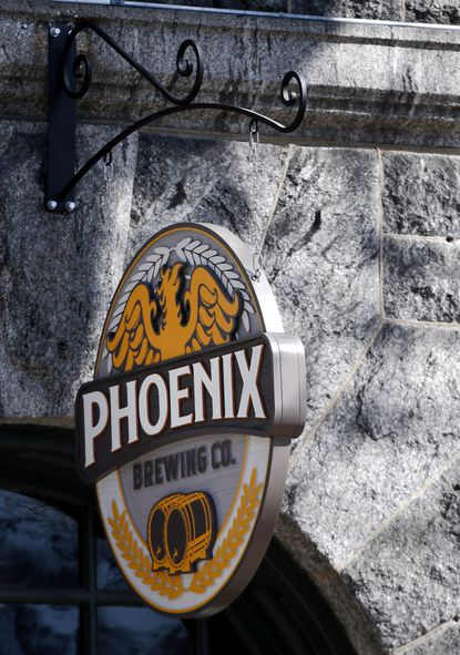 A new sign hangs over the Phoenix Brewing Company on Main Street in historic downtown Ellicott City Thursday, Feb 27, 2020.