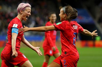 Mallory Pugh of the USA celebrates with teammate Megan Rapinoe after scoring her team's eleventh goal during the 2019 FIFA Women's World Cup France match between the USA and Thailand at Stade Auguste Delaune. (Photo by Robert Cianflone/Getty Images)