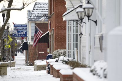 Laurel, MD 021715 Staff Photo by Jen Rynda A snow covered Main Street in Laurel, MD on Tuesday, February 17, 2015.