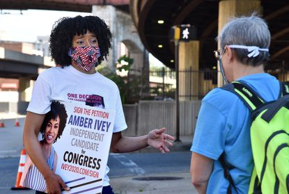A court agreement has made it significantly easier for independent candidates in Maryland — including Baltimore contenders for mayor and Congress — to qualify for the November general election ballot. In this July 12, 2020, photo, plaintiff Amber Ivey, 36, left, an Independent candidate for the 7th Congressional District from Baltimore, speaks with Amy Davidoff of Mount Vernon as she seeks petition signatures to get on the ballot.