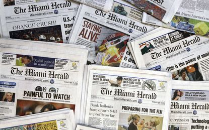 Copies of the McClatchy Co. owned Miami Herald newspaper are shown in Miami. The publisher of the Miami Herald, The Kansas City Star and dozens of other newspapers across the country has filed for bankruptcy protection.