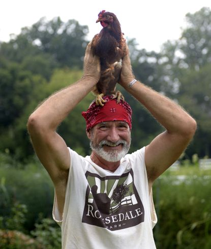 "Steve Rouse may be a full-time farmer these days, but the former radio personality is still enough of a wild-n-crazy guy to put a chicken on his head...As in, Q: ""Hey, would you put a chicken on your head for this next shot?"" A: ""Hell yeah!"""
