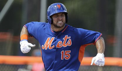 Tim Tebow reacts after hitting a solo home run Wednesday in his first at-bat during the first inning of his first instructional league baseball game.