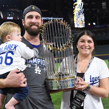 Catonsville High graduate and Los Angeles Dodgers pitcher Adam Kolarek and his wife, Melanie, celebrate the first birthday of their son, Hank, with the World Series trophy after his team won the championship.