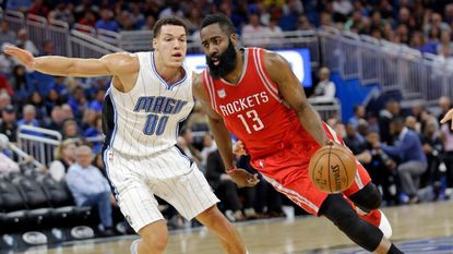 Rockets guard James Harden drives around Magic forward Aaron Gordon during the first half of a game in Orlando on Jan. 6.
