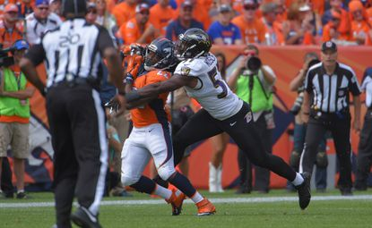 Ravens inside linebacker C.J. Mosley deflects a pass intended for Denver Broncos running back C.J. Anderson during the 2015 season opener at Mile High Stadium.