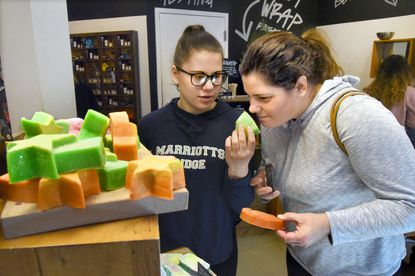 Madison Wray, 14, of Ellicott City, left, with her mother, Cindy Wray, compare soap scents at Lush at The Mall in Columbia in 2018.
