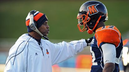Morgan State football coach Lee Hull, left, talks with quarterback Moses Skillon during the Bears' game-winning drive in the fourth quarter Saturday.