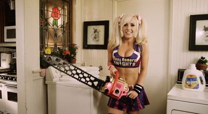 """This promotional model for the upcoming game """"Lollipop Chainsaw"""" was outfitted somehow more appropriately than she is here and was allegedly asked to cover up if she was to remain on the PAX East convention floor."""