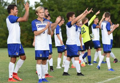 Members of the mens soccer team salute their fans following their 6-3 win over Hagerstown at Carroll Community College on Tuesday, August 27. The game against Hagerstown was the first official athletics contest in the history of the school.