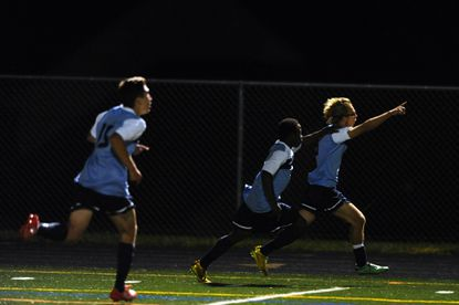 River Hill's Chris Lee, right, seen here celebrating his game-tying goal near the end of regulation against Atholton last week, delivered two goals in the final 20 minutes of regulation on Tuesday to help the Hawks tie Mt. Hebron, 2-2.