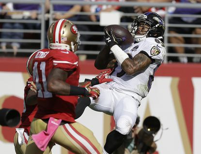 In this Oct. 18, 2015, file photo, Ravens wide receiver Steve Smith Sr. catches a 34-yard touchdown pass in front of San Francisco 49ers strong safety Antoine Bethea and cornerback Kenneth Acker during the second half of an NFL football game in Santa Clara, Calif.