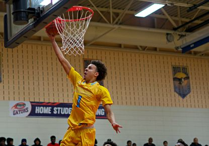 River Hill's Nick Marshall goes up for a basket during a playoff game at Reservoir on March 3, 2020.
