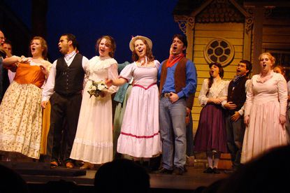 """From left, Rebecca Feibel (as Aunt Eller), Ben Harris (Curly), Emily Mudd (Laurey), Nicole Bowen (Ado Annie) and Nathan Bowen (Will Parker), with ensemble players to the right, sing during 2nd Star's production of """"Oklahoma."""""""