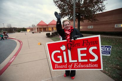 Board of Education candidate Ellen Flynn Giles stands outside Mount View Middle School.
