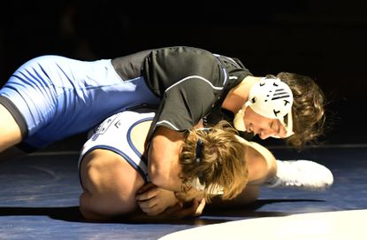 C. Milton Wright's Logan Dvorak keeps the pressure on Bel Air opponent Cade Zengel as he goes for the pin in the 170 pound match during Wednesday evening's wrestling meet at Bel Air.