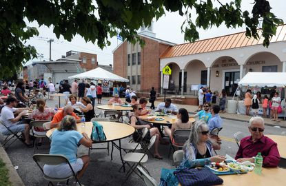 People enjoy food and beverages at the St. Nicholas Greek Folk Festival, which was held this weekend on Ponca Street.