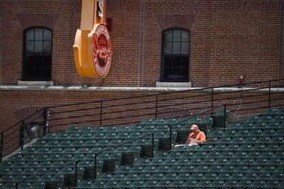 Jeff Brown, of Arlington, Va., has a whole section of seats on right filed to himself. He is among the 9 thousand plus fans attending the game at Oriole Park at Camden Yards on Jun 6, 2021.