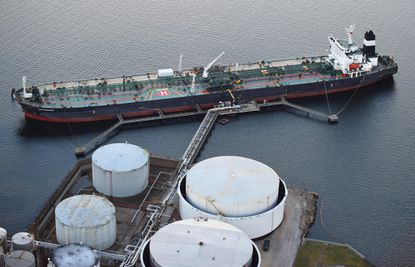 A tanker is moored at the Apex Oil terminal at S. Clinton Street in Baltimore's Inner Harbor.