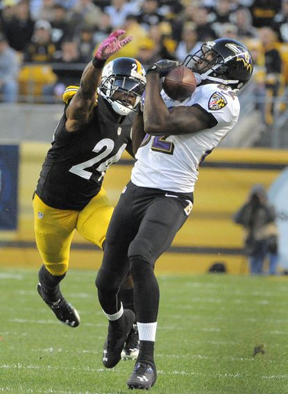 Ravens wide receiver Torrey Smith hauls in a long third-quarter pass against Pittsburgh in an Oct. 20 loss.