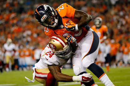 Shareece Wright of the San Francisco 49ers tackles Denver Broncos running back Ronnie Hillman during preseason action at Sports Authority Field at Mile High on August 29, 2015 in Denver, Colorado. Wright asked for and was granted his release by San Francisco and was signed by the Ravens on monday.