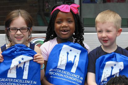 Pictured left to right, Konstantina Loizou, left, Milan Jones, center, and Logan Thomas of Halls Cross Elementary School in Aberdeen were looking to bringing home their new books, provided by the Greater Excellence in Education Foundation in an effort to keep children reading over the summer.