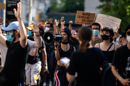 Livia Rose Johnson, center, a member of Warriors in the Garden, leads a protest against police violence in Manhattan, June 4, 2020. She is among the mix of newly minted activists and more seasoned hands leading protests across New York City.